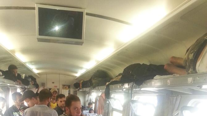 Refugees rest in carriage of a train at Bicske railway station