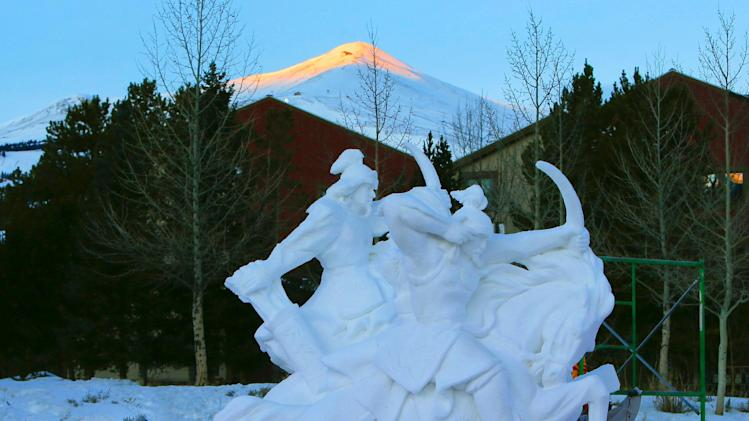 Artists of Team Mongolia work in the early morning sunrise hours on their snow sculpture, The Mongolian Warriors make it to look like marble at the outdoor gallery at the Riverwalk Center during the 23 annual International Snow Sculpture Championships in Breckenridge, Colo., on Saturday, Jan. 26, 2013. Each of the 15 sculpture started out of a 12 foot tall, 20-ton block of compacted snow at the outdoor art gallery. The sculptures will remain on display through Feb. 3, 2013, weather permitting. Visit www.gobreck.com for more information. (Nathan Bilow / AP Images for the Breckenridge Resort Chamber)