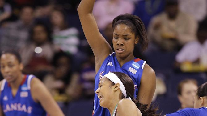 Notre Dame guard Skylar Diggins (4) slams into Kansas forward Chelsea Gardner (15) during the first half of a regional semi-final of the NCAA college basketball tournament Sunday  March 31, 2013 in Norfolk, Va.  (AP Photo/Steve Helber)