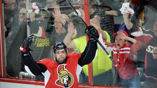 Ottawa Senators forward Clarke MacArthur celebrates a goal against the Montreal Canadiens during the first period of game 3 of first round Stanley Cup NHL playoff hockey action in Ottawa, Ontario, on Sunday, April 19, 2015.  Sean Kirkpatrick/The Canadian Press via AP)   MANDATORY CREDIT