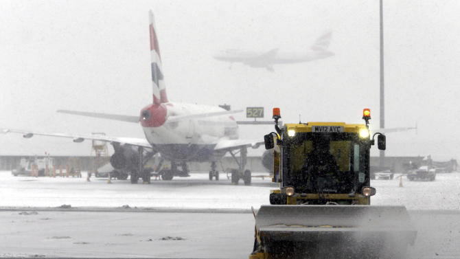 Snow forces Heathrow to briefly close a runway