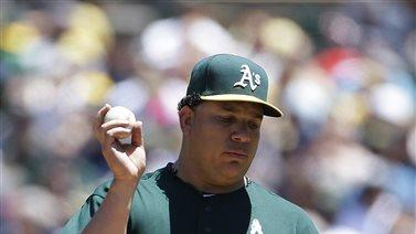 Colon wins 6th straight as A's rout Mariners 10-2