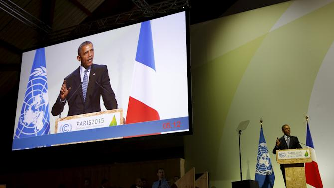U.S. President Barack Obama participates in the COP21 session on statements by heads of state and government at the climate summit in Paris