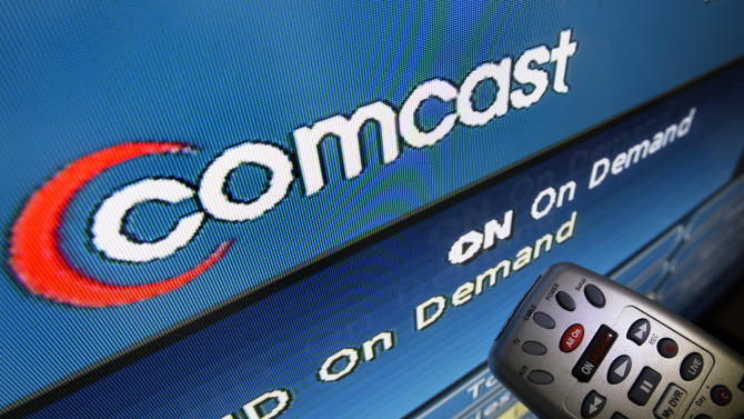 FILE - In this Aug. 6, 2009 file photo, the Comcast logo is displayed on a TV set in North Andover, Mass. After years of bickering, Netflix and Comcast are finally working together to provide their subscribers with a more enjoyable experience when they're watching movies and old television shows over high-speed Internet connections. The new partnership is part of a breakthrough announced Sunday, Feb. 23, 2014, that requires Comcast's Internet service to create new avenues for Netflix's video to travel on its way to TVs and other devices. (AP Photo/Elise Amendola, File)