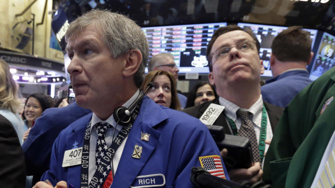 Traders work on the floor of the New York Stock Exchange, Friday, Jan. 25, 2013. Stocks are opening higher on Wall Street ahead of what is expected to be more upbeat data on housing from the government. (AP Photo/Richard Drew)