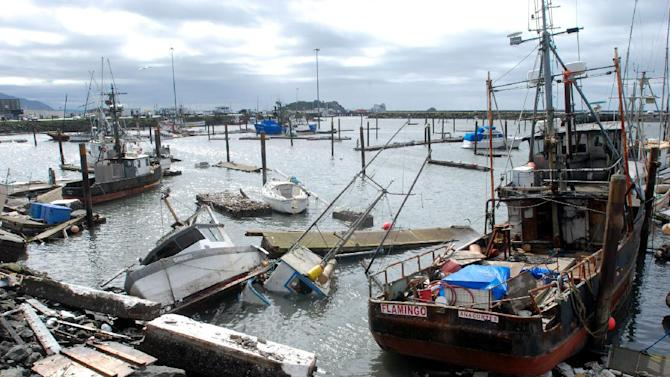 A March 12, 2011 photo shows sunken and damaged boats in the boat basin at Crescent City, Calif., after a powerful tsunami sent repeated surges that broke up docks and tore loose boats. After one tsunami after another over the decades, the port hopes that repairs under way will make the harbor able to withstand a similar tsunami in the future. (AP Photo/Jeff Barnard)