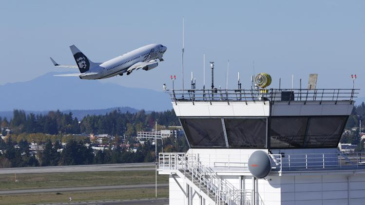 An Alaska Airlines plane takes off Monday, Oct. 28, 2013, from Seattle-Tacoma International Airport in Seattle. The modernization of the U.S. air traffic control system, one of the government's most ambitious and complex technology programs, is in trouble. The Next Generation Air Transportation System, or NextGen, was sold to Congress and the public by the Federal Aviation Administration a decade ago as a way to accommodate an anticipated surge in air travel, reduce fuel consumption and improve safety and efficiency. (AP Photo/Ted S. Warren)