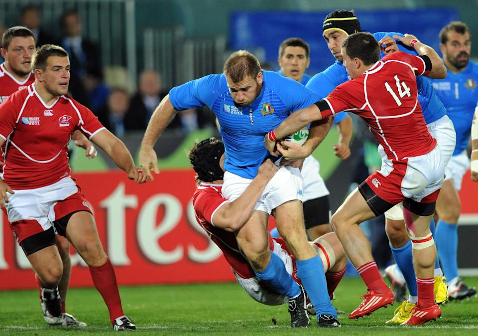 Italy's Fabio Ongaro breaks the Russian defence during their Rugby World Cup pool match at Trafalgar Park, Nelson, New Zealand, Tuesday, September 20, 2011. (AP Photo/SNPA, Ross Setford) **NEW ZEALAND OUT**