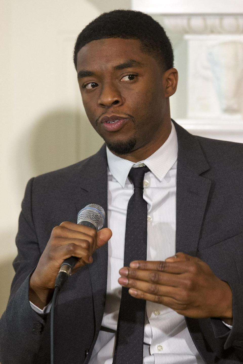 "Actor Chadwick Boseman, who plays baseball great Jackie Robinson in the movie ""42"" speaks on a panel, hosted by first lady Michelle Obama, of the cast and crew of the movie, Tuesday, April 2, 2013, in the State Dining Room of the White House in Washingto. (AP Photo/Jacquelyn Martin)"
