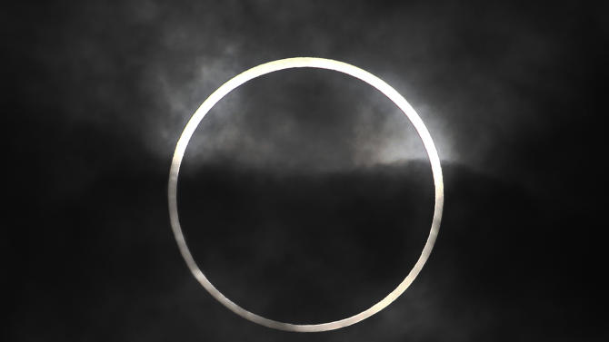 "An annular solar eclipse in seen from Machida, on the outskirts of Tokyo, Monday, May 21, 2012. Millions across Asia are watching as a rare ""ring of fire"" eclipse is crossing their skies. The annular solar eclipse, in which the moon passes in front of the sun leaving only a golden ring around its edges, was visible to wide areas across the continent Monday morning. (AP Photo/Itsuo Inouye)"
