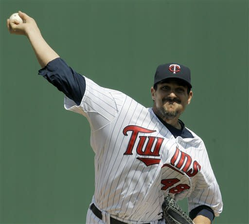 Mauer and Morneau drive in runs, Twins beat Rays