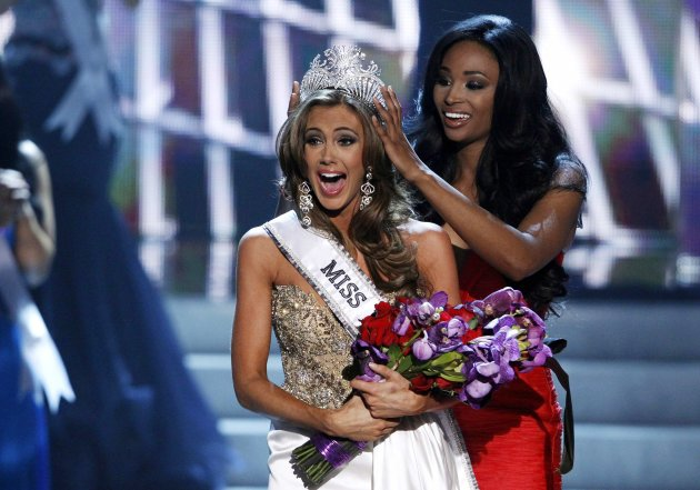 Miss Connecticut Erin Brady reacts as she is crowned by Miss USA 2012 Nana Meriwether during the Miss USA pageant at the Planet Hollywood Resort and Casino in Las Vegas, Nevada June 16, 2013. REUTERS/Steve Marcus (UNITED STATES - Tags: ENTERTAINMENT TPX IMAGES OF THE DAY) FOR EDITORIAL USE ONLY. NOT FOR SALE FOR MARKETING OR ADVERTISING CAMPAIGNS