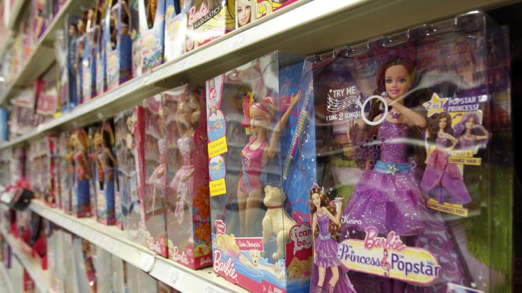 In this Monday, July 16, 2012 photo, Barbie products are displayed at a local toy store in Hialeah, Fla. Demand for doll brands including Barbie, American Girl and Monster High, coupled with lower sales costs and advertising expenses, helped the biggest U.S. toy maker's net income rise 20 percent in the second quarter. Mattel, which also makes Hot Wheels and Fisher-Price toys, said Tuesday, July 17, 2012,  that its net income rose to $96.2 million, or 28 cents per share, in the April to June quarter. (AP Photo/Alan Diaz)
