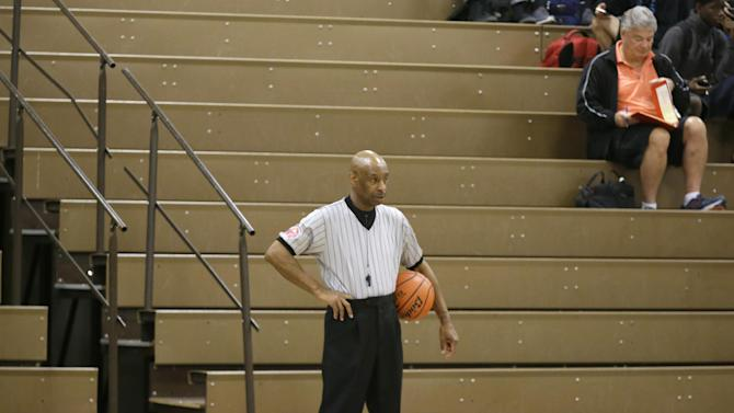 In this Thursday, Nov. 12, 2015, photo, Spenser Simmons, a referee with the North Texas Basketball Officials Association, stands ready during a break during a high school freshman girls basketball game in Allen, Texas. Violence against referees is as old as sport itself, and most are familiar with awful scenes from lower-division soccer matches in Europe and South America to peewee games and high school tournaments in the United States. This has come at a cost: By all accounts from those involved, finding and retaining referees is becoming more and more difficult. (AP Photo/LM Otero)