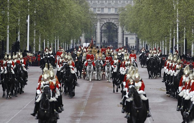 The carriage carrying Britain's Queen Elizabeth II and Prince Philip returns from Houses of Parliament for the State Opening of Parliament, to Buckingham Palace in London, Wednesday, May 9, 2012. From