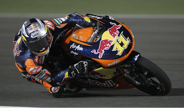 Moto3 rider Sandro Cortese (R) of Germany competes in the final race of the Grand Prix of Qatar at the Losail International Ciruit in Doha on April 8, 2012. Spain's Maverick Vinales, on a FTR Honda, f
