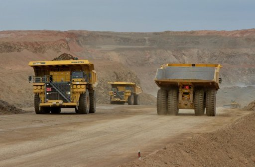 <p>File photo of mining work at the Oyu Tolgoi gold and copper mine which is operated by Rio Tinto and Ivanhoe Mines in south east Mongolia. An Australian lawyer working for a mining company in Mongolia has been stopped from leaving the country, Foreign Minister Bob Carr said Wednesday, as authorities probe a case of alleged corruption.</p>
