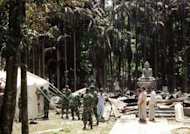 Soldiers from the Bangladesh Army erect tents at the torched Lal Ching Buddhist temple at Ramu, on October 1, 2012. Bangladesh police have arrested nearly 300 people after Muslim mobs attacked temples and houses in what Buddhist leaders described as the worst violence against the community since independence