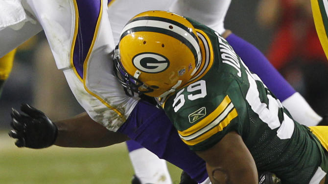 Green Bay Packers linebacker Brad Jones (59) tackles Minnesota Vikings quarterback Brett Favre by the ankle during the second half of an NFL football game Sunday, Oct. 24, 2010, in Green Bay, Wis.  Favre has a stress fracture in his left ankle that could end the quarterback's NFL-record consecutive games streak. Minnesota Vikings coach Brad Childress said Monday, Oct. 25, 2010 an MRI revealed the injury after the 28-24 loss at Green Bay on Sunday night. Childress said the 41-year-old Favre is wearing a walking boot. (AP Photo/Jeffrey Phelps)