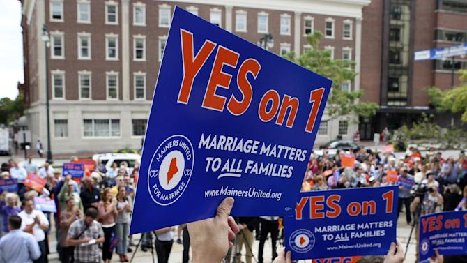 FILE - In this Sept. 10, 2012, file photo, gay marriage supporters gather at a rally outside of City Hall in Portland, Maine, in support of an upcoming ballot question that seeks to legalize same-sex marriage. On one aspect of whether same-sex couples should have the right to marry, both sides agree: The issue defines what kind of nation we are. Half a dozen states and the District of Columbia have made history by legalizing it, but it's prohibited elsewhere, and 30 states have placed bans in their constitutions. (AP Photo/Joel Page, File)