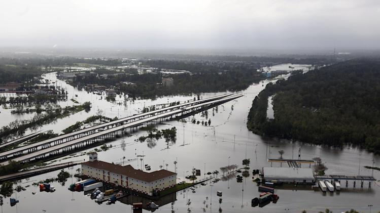 This aerial photo shows Interstate 10, partially submerged by floodwaters,  in LaPlace, La., Thursday, Aug. 30, 2012. Isaac soaked Louisiana for yet another day and pushed more water into neighborhoods all around the city, flooding homes and forcing last-minute evacuations and rescues. (AP Photo/Gerald Herbert)