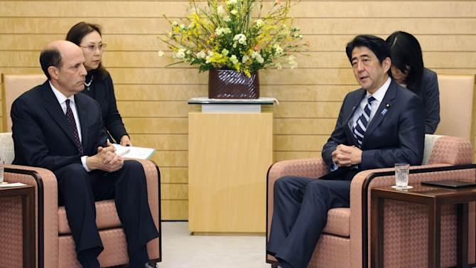 Japanese Prime Minister Shinzo Abe, right, and  U.S. Ambassador to Japan John V. Roos meet at Abe's official residence in Tokyo following North Korea's nuclear test, Tuesday, Feb. 12, 2013. Defying U.N. warnings, North Korea on Tuesday conducted the underground nuclear test in the remote, snowy northeast, taking a crucial step toward its goal of building a bomb small enough to be fitted on a missile capable of striking the United States. (AP Photo/Kyodo News) JAPAN OUT, MANDATORY CREDIT, NO LICENSING IN CHINA, HONG KONG, JAPAN, SOUTH KOREA AND FRANCE
