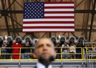 Shipyard workers listen as U.S. President Barack Obama speaks at Newport News Shipbuilding in Newport News, Virginia February 26, 2013. REUTERS/Kevin Lamarque