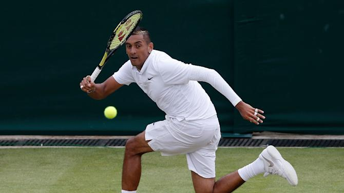 Australia's Nick Kyrgios returns to France's Richard Gasquet during their fourth round match on day seven of the 2015 Wimbledon Championships in Wimbledon, southwest London, on July 6, 2015