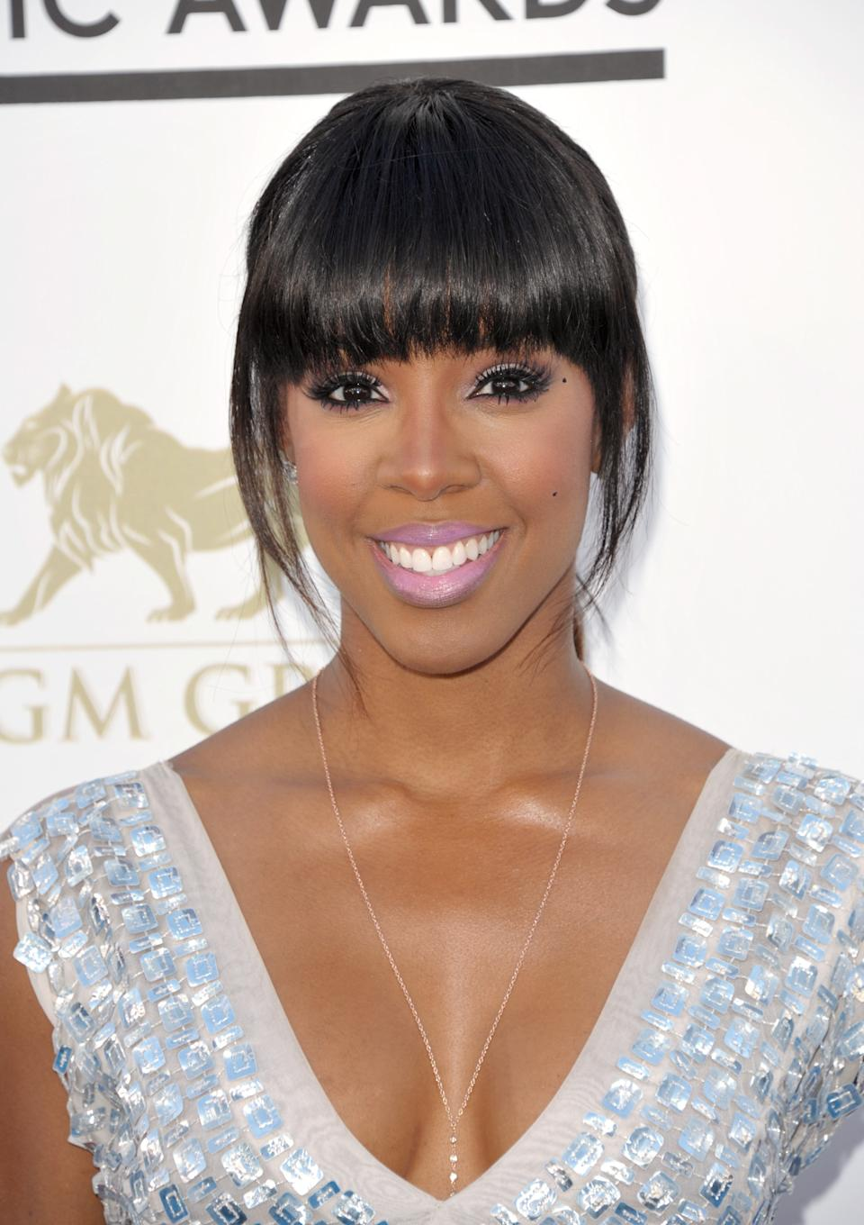 Kelly Rowland arrives at the Billboard Music Awards at the MGM Grand Garden Arena on Sunday, May 19, 2013 in Las Vegas. (Photo by John Shearer/Invision/AP)