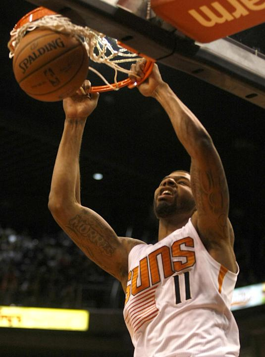 Phoenix Suns power forward Markieff Morris (11) dunks in the third quarter during an NBA basketball game against the Charlotte Bobcats, Saturday, Feb. 1, 2014, in Phoenix