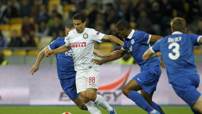 Dnipro Dnipropetrovsk's players chase Inter Milan's Hernanes during their Europa League soccer match at the Olympic stadium in Kiev