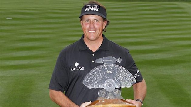 Phil Mickelson holds the championship trophy after winning the Waste Management Phoenix Open at TPC Scottsdale