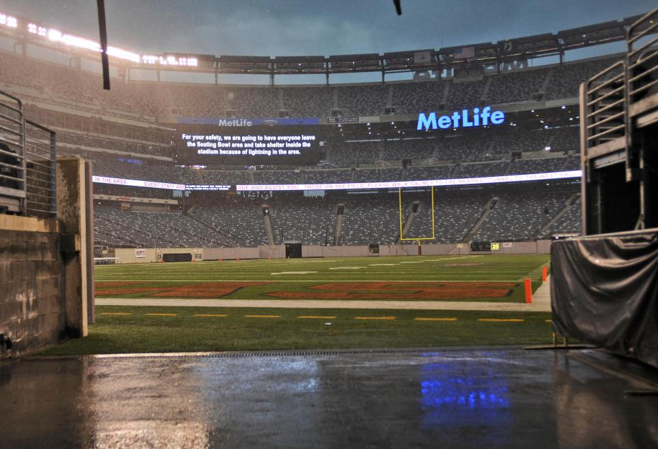 The field and stands are empty after the NCAA college football game between Southern California and Syracuse was halted because of storms, Saturday, Sept. 8, 2012, in East Rutherford, N.J. (AP Photo/Bill Kostroun)