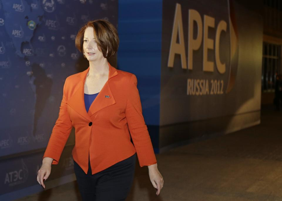 Australian Prime Minister Julia Gillard walks from her car to a press conference at the APEC summit in Vladivostok, Russia, Friday, Sept. 7, 2012. (AP Photo/Mark Baker)