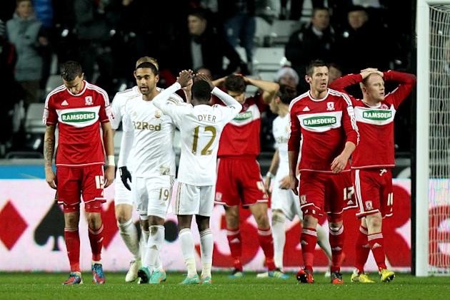 Swansea winger Nathan Dyer, centre, celebrates Seb Hines' own goal