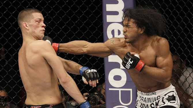 Ben Henderson, right, punches Nate Diaz during the third round of a lightweight championship mixed martial arts bout at a UFC on Fox event in Seattle, Saturday, Dec. 8, 2012. Henderson won by unanimous decision to retain his championship. (AP Photo/Jeff Chiu)