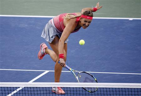 Azarenka of Belarus hits a return to Serena Williams of the U.S. during their women's singles final match at the U.S. Open tennis championships in New York