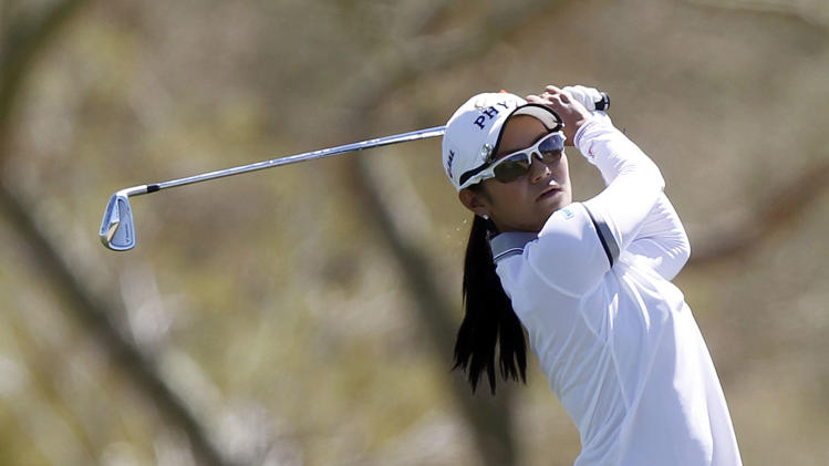 Ai Miyazato, of Japan, follows through on her approach shot from the third fairway during the first round of the Founders Cup golf tournament on Thursday, March 14, 2013, in Scottsdale, Ariz. (AP Photo/Paul Connors)