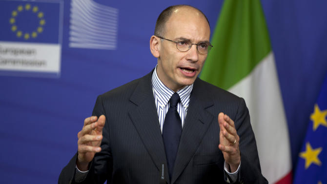 Italian Prime Minister Enrico Letta gestures as he speaks during a newas conference at EU headquarters in Brussels on Thursday, May 2, 2013. Letta has pressed for the creation of a full-fledged European banking union and said he wants results before the EU summit next month. (AP Photo/Virginia Mayo)