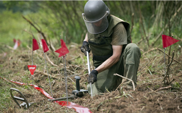 Ante Ivanda, a de-miner, searches for land mines in Petrinja, central Croatia, Friday, May 17, 2013.  Croatian researches, working on a unique method to find unexploded mines that are littering their 