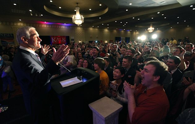 Republican presidential candidate Rep. Ron Paul, R-Texas, takes in the applause of the crowd as he address a crowd during the North Dakota caucus Tuesday, March 6, 2012, in Fargo, N.D. (AP Photo/Charl