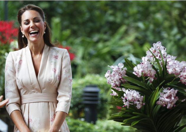 Kate, Duchess of Cambridge, smiles during a ceremony naming a hybrid orchid in their honor at the Orchid Garden within the Singapore Botanical Gardens in Singapore, Tuesday, Sept. 11, 2012. The Duke a