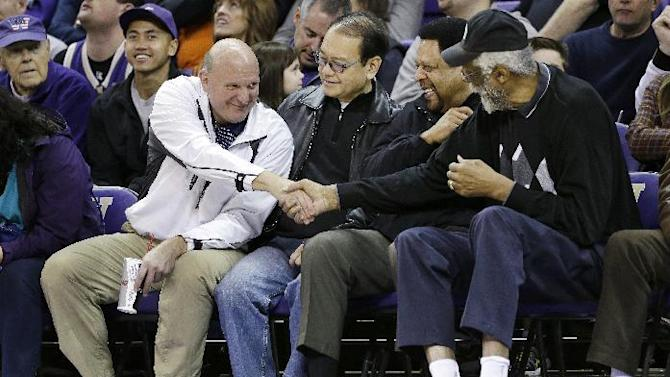 """FILE - In this Jan. 25, 2014, photo, then-Microsoft CEO Steve Ballmer, left, shakes hands with former NBA players Bill Russell, right, and """"Downtown"""" Freddie Brown as Omar Lee looks on during an NCAA college basketball game between Washington and Oregon State in Seattle. Ballmer is officially the new owner of the Los Angeles Clippers. The team says the sale closed Tuesday, Aug. 12, 2014, after a California court confirmed the authority of Shelly Sterling, on behalf of the Sterling Family Trust, to sell the franchise. (AP Photo/Elaine Thompson, File)"""