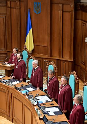 Vasyl Bryntsev (L), one of Ukraine's constitutional court judges, reads findings of the court during the sitting in Kiev, Ukraine on July 31, 2015
