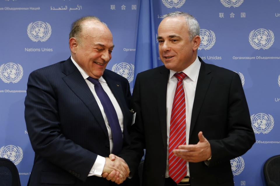 Palestinian Finance Minister Shukri Bishara, left, shakes hands with Israeli Foreign Minister Yuval Steinitz after a press conference regarding a meeting of the Ad Hoc Liaison Committee during the 68th session of the United Nations General Assembly at U.N. headquarters, Wednesday, Sept. 25, 2013. (AP Photo/Jason DeCrow)