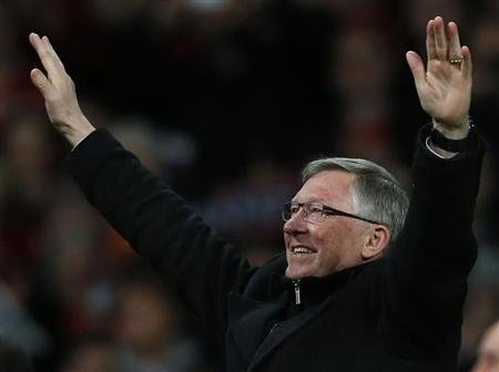 Manchester United's manager Ferguson celebrates after his team clinched the English Premier League soccer title with a win against Aston Villa at Old Trafford in Manchester