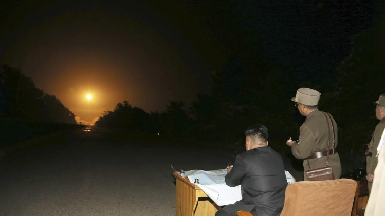 KCNA picture shows North Korean leader Kim Jong Un providing field guidance during a tactical rocket firing drill carried out by units of the KPA Strategic Force in the western sector of the front