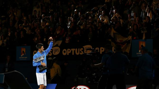 Djokovic of Serbia does a lap of honour after defeating Murray of Britain to win their men's singles final match at the Australian Open 2015 tennis tournament in Melbourne