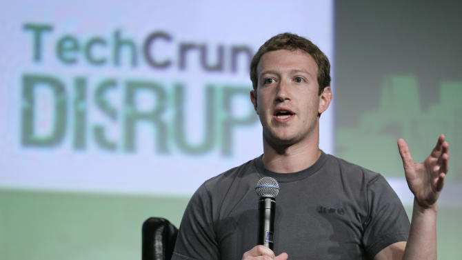 "Facebook CEO Mark Zuckerberg speaks during a ""fireside chat"" at a conference organized by technology blog TechCrunch in San Francisco, Tuesday, Sept. 11, 2012.  Zuckerberg gave his first interview since the company's rocky initial public offering in May. (AP Photo/Eric Risberg)"