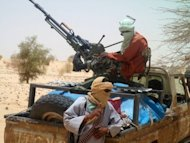 Islamists rebels of Ansar Dine are pictured on April 24, near Timbuktu. Tuareg rebels, militias and Islamist groups are committing war crimes in Mali's lawless north, including summary executions and rapes, Human Rights Watch says